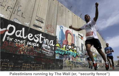 Palestinians_running_by_Wall